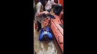 Man Bending to Help Women board Boat in Kerala, video goes viral