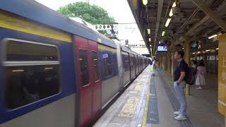 MTR: Lo Wu bound MLR East Rail Line Train leaving Sheung Shui